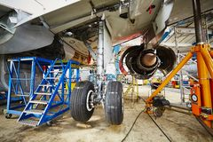 Heavy maintenance. Chassis of the airplane under heavy maintenance Royalty Free Stock Photos