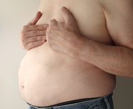 Heavy man with pain in chest Royalty Free Stock Images