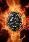 Heavy metal brain. 3D render of grungy metal brain with fire background Stock Photos