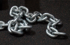 Heavy metal chain for strength training on the floor Royalty Free Stock Images