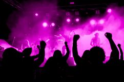 Heavy Metal Concert with Ultra Violet Lights. Heavy metal concert with bright ultra violet lights stock photos