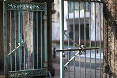 Heavy metal gates. Heavy metal wrought-iron gates of the botanical garden with exit to city street Stock Images
