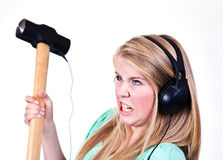 Heavy metal girl. Heavy metal music from a sledgehammer Royalty Free Stock Image