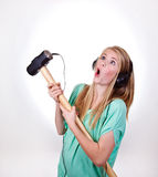 Heavy metal girl. Heavy metal music from a sledgehammer Stock Photo