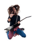 Heavy metal guitarist jumps in the air Stock Image