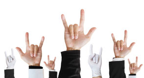 Heavy metal hand sign of difference career raising upward, isolated on white background. Heavy metal hand sign of difference career raising upward. isolated on Stock Photos