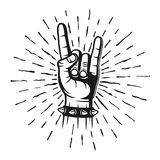 Heavy metal horns hand gesture stamp with rays. Vector monochrome illustration in vintage style isolated on white background Stock Image