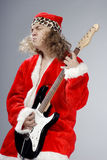 Heavy metal music of Santa Claus Stock Photo