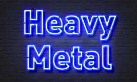 Heavy metal neon sign. On brick wall background Royalty Free Stock Photos