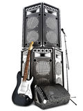 Heavy metal , rock and roll background with large tower speakers. Amp , microphone and electric guitar on a white background Royalty Free Stock Photography