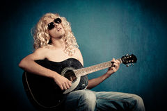Heavy metal rock star with guitar parody Royalty Free Stock Images
