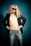 Heavy metal rock star parody. Heavy metal rock star man with long blond curly hair and sunglasses parody Stock Photos