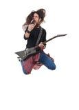 Heavy metal rocker jumps stock photos