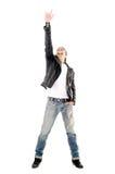 Heavy metalstjärnadanande en vagga - och - rulla gesten arkivfoto