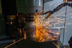 Heavy milling of thick hardened plate with sparks under air blow. Heavy milling with sparks caused overheating due to wrong cutting feeds and speeds. Safety stock photos