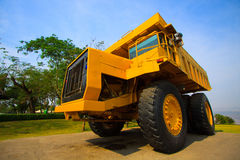 Heavy mining truck in mine and driving along the opencast. Photo of the big mine truck, The career heavy-load super car.  Royalty Free Stock Photo