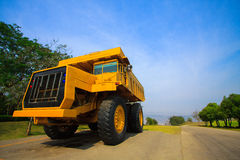 Heavy mining truck in mine and driving along the opencast. Photo of the big mine truck, The career heavy-load super car Royalty Free Stock Photos
