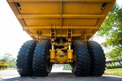 Heavy mining truck in mine and driving along the opencast. Photo of the big mine truck, The career heavy-load super car Stock Photo