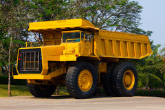 Heavy mining truck in mine and driving along the opencast. Photo of the big mine truck, The career heavy-load super car.  Royalty Free Stock Photos