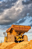 Heavy mining truck at sunset Stock Images