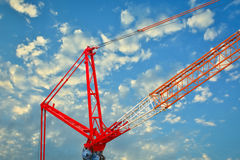 Heavy mobile crane lifting large object. Stock Photos