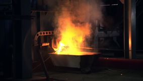 Heavy molten metal at modern furnace with hot sparks shower stock video footage
