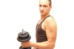 Heavy muscle. Athlete holds a weight and shows his muscles Royalty Free Stock Photography