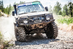 Heavy off-road racing car driving along the dusty road. TOLOKUN`, UKRAINE - JULY 2, 2016 :ATL TROPHY 2016. III stage of offroad trophy Ukrainian championship Royalty Free Stock Image