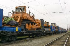Bulldozers for accident recovery work. Heavy orange bulldozers stands on the flatcar of the train for accident recovery work royalty free stock image