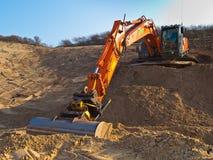 Heavy orange excavator Royalty Free Stock Image