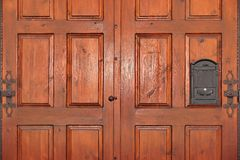 Heavy Paneled Double leaf Mahogany Hardwood Door With Iron Mailb Stock Images