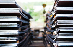 Heavy plates made of steel. Stack of steel plates cut to different shapes Stock Image