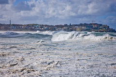 Heavy powerful seas. During a cyclone with the wind whipping spray off white breakers at Bondi Beach, Sydney, Australia Stock Photos