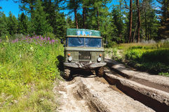 Heavy powerful truck-terrain vehicle with off-road wheels Royalty Free Stock Images