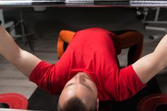 Heavy Powerlifter Weight Barbell Exercise Benchpress in Powerlif. Strong Man Lifting Heavy Barbell During Powerlifting Workout in Gym royalty free stock image