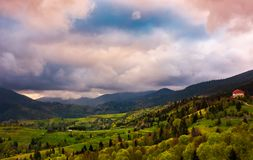 Heavy purple clouds over the rural countryside. Beautiful landscape of Carpathian mountains in springtime Stock Photo