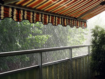 Heavy Rain. In the summer time under an awning Stock Photography