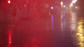 Heavy rain on city streets, blurred slow motion stock footage