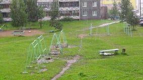 Heavy rain in city yard stock footage