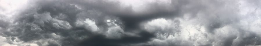 Heavy rain clouds. Heavy dar rain clouds up in the sky panorama royalty free stock photography