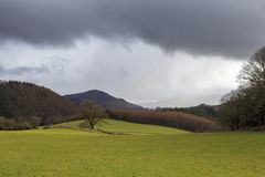 Heavy rain clouds. Form over Coed Y Brenin Forest, Snowdonia royalty free stock image