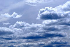 Heavy rain clouds. High quality photo of gorgeous deep dark gray with blue sky full of different cumulus or rain clouds. High-contrast colors, interesting Royalty Free Stock Photography