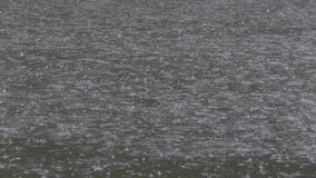Heavy Rain Drops on the Water Surface stock video footage