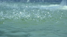 Heavy rain falling on water surface, water drops stock footage