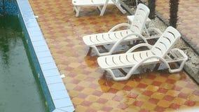 Heavy rain falls into a swimming pool. Not season, dirty abandoned pool stock video