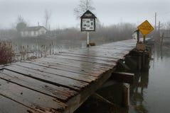 Heavy Rain, Finn Slough, Richmond, BC. A foot bridge in the quaint and historic fishing settlement of Finn Slough on the banks of the Fraser River near Steveston Royalty Free Stock Images