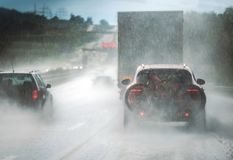 Heavy Rain Highway Traffic. Extreme Road Conditions. Rainy Weather Driving Stock Photography