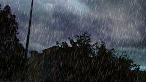 Heavy rain modren mall behind trees. In south jeddah stock video