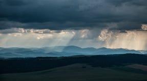 Heavy rain. Over hills in distance stock photo