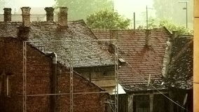 Heavy Rain Over Old Roofs Wider stock footage